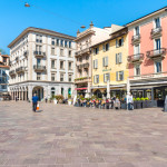 View of Piazza della Riforma with many bars, restaurants and bistros, is main square in the historic center of Lugano.