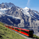 a cogwheel train of the famous Jungfrau Railway from Jungfraujoch to Kleine Scheidegg, Bernese Oberland, Switzerland