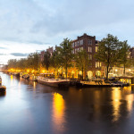 Canals of Amsterdam at night. Amsterdam is the capital and most populous city of the Netherlands