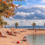 Famous croatian beach called Kasuni Beach, by the Adriatic Sea, in Split, Croatia.