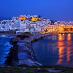 NAXOS ISLAND, CYCLADES, AEGEAN SEA, GREECE, Night view of Chora, the capital town of the island from Portara.