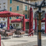Porec, Istria, Croatia - An empty restaurant terrace located in one of the town squares