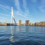View to the Erasmus-Bridge and buildings at Prins Hendrikkade, South Holland, Netherlands, Rotterdam