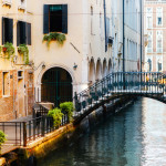 Canal in Venice, Italy and colorful buildings with a pedestrian bridge