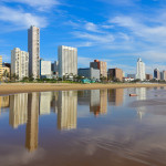 Reflection of Durban's Golden Mile beachfront in the Indian Ocean, KwaZulu-Natal province of South Africa