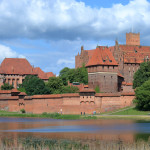 View at tuetonic castle in Malbork, Poland, from opposite river bank
