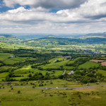 Aerial view of green farmland and fields in the rural Welsh countryside