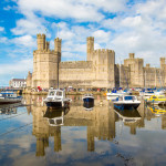 Caernarfon Castle in Wales in a beautiful summer day