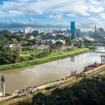View of the Marginal Pinheiros Avenue, Pinheiros River and skyline of Sao Paulo city on sunny summer day