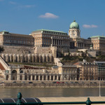 Budapest, Hungary, A large and imposing palace is located on a hill that overlooks the Danube River in Budapest