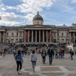 Locals and tourists walking in front of The National Gallery in London