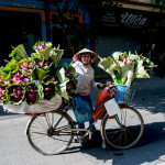 Vietnamese woman sells flowers at a street market in Nam Dinh. Vietnam