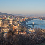 View of Budapest and the Danube River as Seen from Gellert Hill Lookout Point with Bare Trees and Bushes