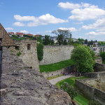 Walls and main gate of rampart of the Eger fort (castle) with medieval town of Eger at background . Hungary