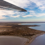 Aerial view of flood water entering Lake Eyre salt lake in outback Australia following long period of drought