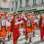 Children in national costumes at a parade in the city centre of Lviv, Ukraine