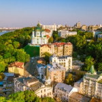 Saint Andrew's church and Andreevska street from above, cityscape of Podol district on sunset, skyline of city of Kiev,Ukraine