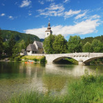 View of the old bridge and the church in Bohinj, Slovenia